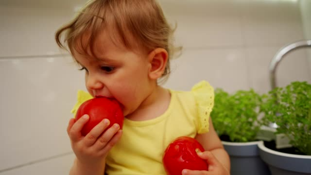 cute little girl eating fresh tomato - toddler stock videos & royalty-free footage