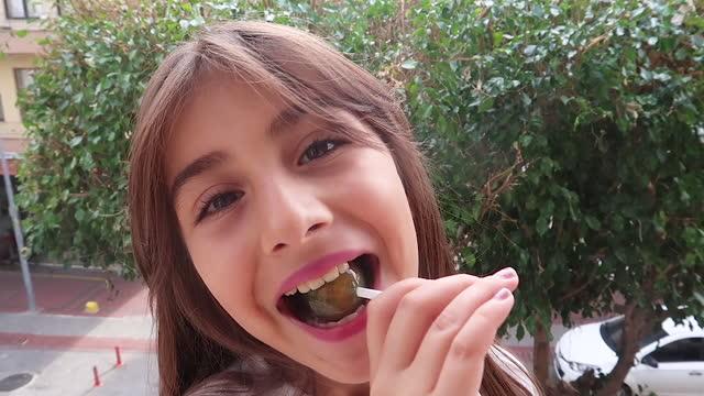cute little girl eating lollipop - lollipop stock videos & royalty-free footage