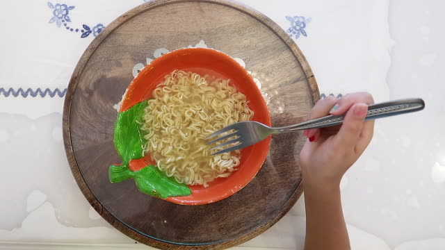 cute little girl eating noodles - plate stock videos & royalty-free footage