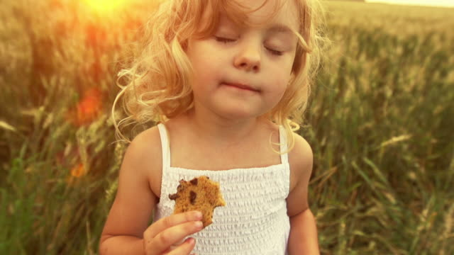 Cute little girl eats a cookie