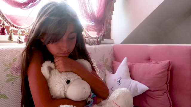 cute little girl embracing to her teddy - brown hair stock videos & royalty-free footage