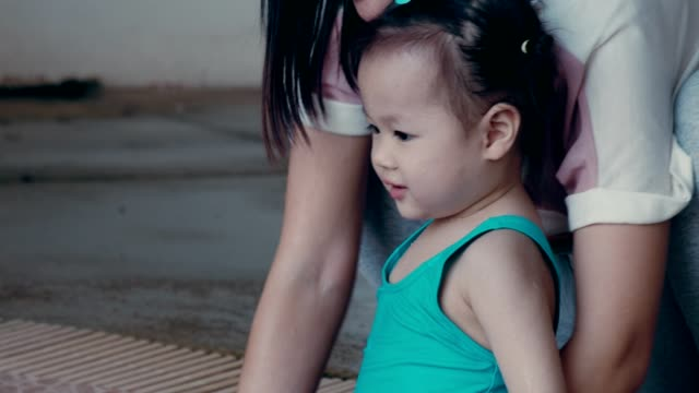 cute little girl(2-3 years) enjoy learning to swim with her mother - 2 3 years stock videos & royalty-free footage