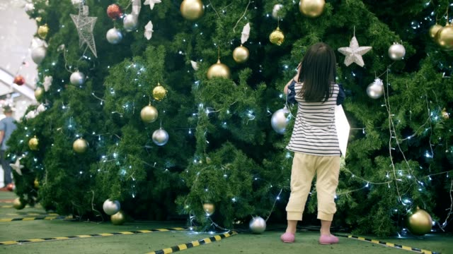 cute little girl(4-5 years) excitement in christmas festival - 4 5 years stock videos and b-roll footage