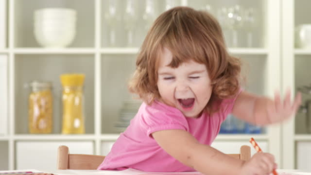 hd: cute little girl having fun while drawing - pencil stock videos and b-roll footage