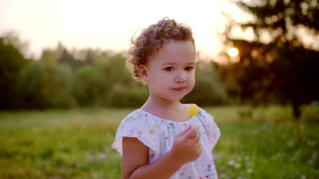 cute little girl holding lollipop - lollipop stock videos and b-roll footage