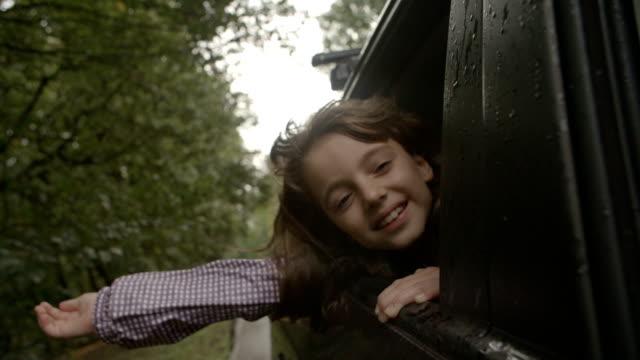 HD: Cute Little Girl In Car.
