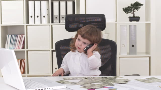 hd: cute little girl running a business in office - adult imitation stock videos & royalty-free footage