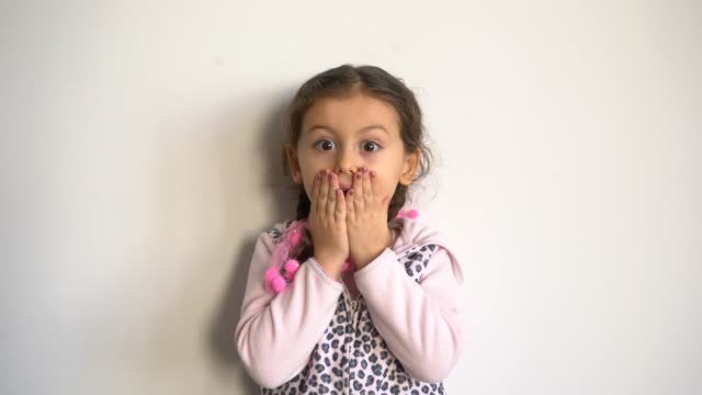 cute little girl surprised over gray background - mouth open stock videos and b-roll footage
