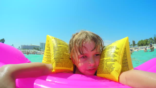 Cute Little Girl Swimming in the Cyprus Sea