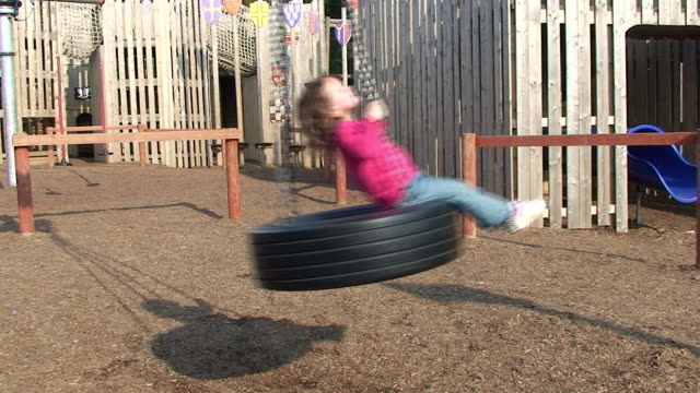 cute little girl swinging - swinging stock videos and b-roll footage