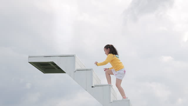 cute little girl walking up the stairs, the ladder of success - ladder of success stock videos & royalty-free footage