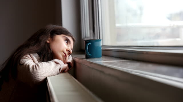 cute little girl with a cup by the window - cold temperature stock videos & royalty-free footage