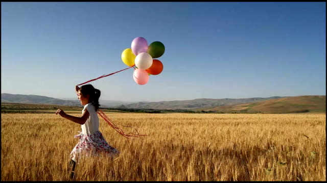 cute little girl with balloons at field - baby girls stock videos & royalty-free footage