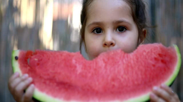 cute little toddler eating a fresh fruit in summer time - chewing stock videos & royalty-free footage