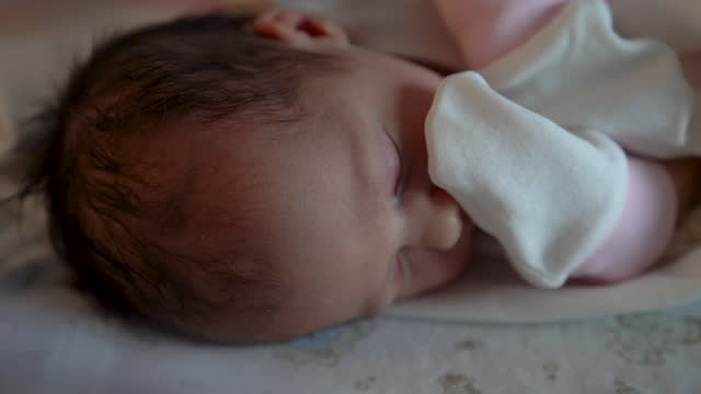 cute newborn baby girl is sleeping - occurrence stock videos & royalty-free footage