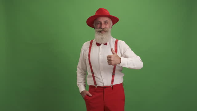 cute old man shows copy space and shows thumbs up - suspenders stock videos & royalty-free footage