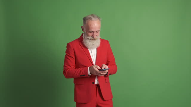 cute old man writing message on smartphone - avoidance stock videos & royalty-free footage