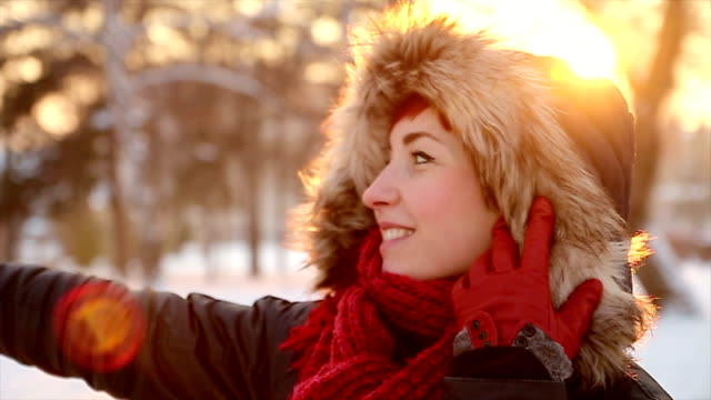 Cute red head woman enjoying in sunny winter day