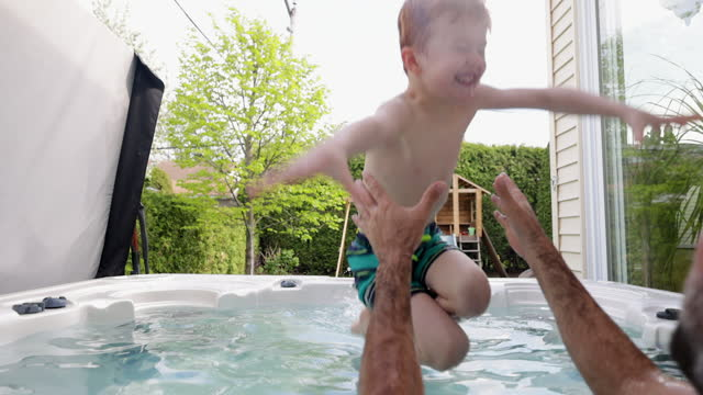 cute redhead kid and father in the hot tub in the backyard in summer - hot tub stock videos & royalty-free footage