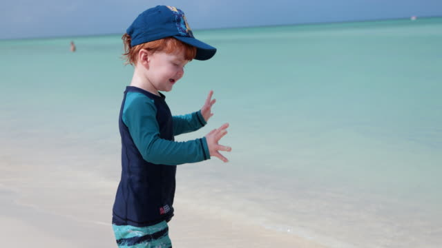 cute redhead toddler dancing on beach - cap stock videos & royalty-free footage