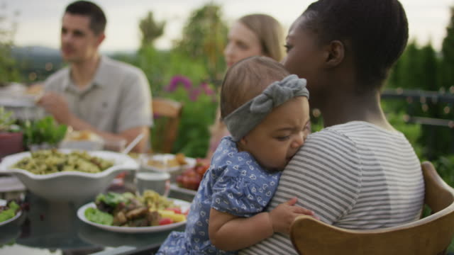 cute restless baby at an outdoor dinner party - pacific islander family stock videos & royalty-free footage