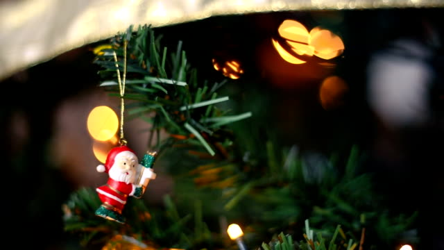 cute santa clauss ornament hanging from the christmas tree - hanging up stock videos and b-roll footage