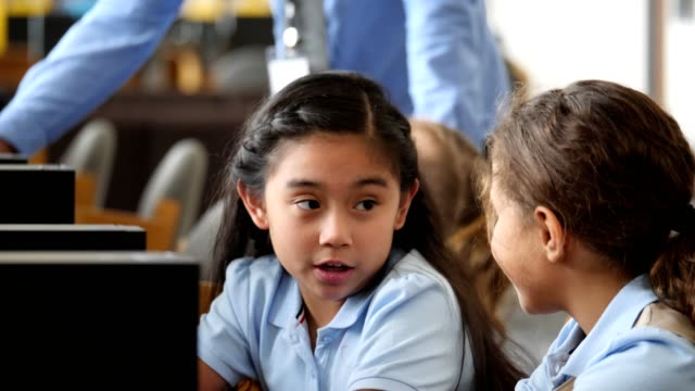 cute schoolgirls use computer in computer lab - first day of school stock videos & royalty-free footage