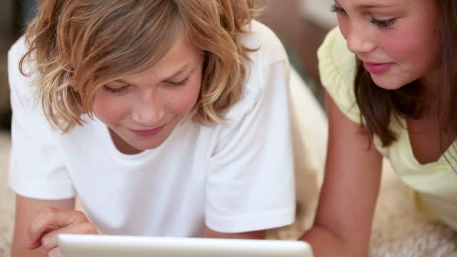 Cute siblings using a tablet computer
