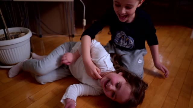 cute siblings wrestling and tickling each other - children only stock videos & royalty-free footage