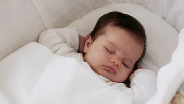 cute sleeping baby girl - tutina video stock e b–roll