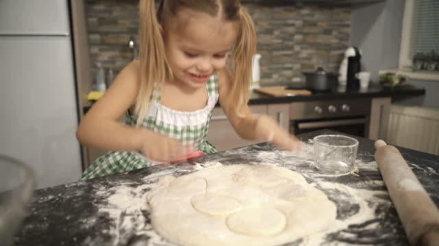 cute small girl having fun with raw dough in the kitchen. - one girl only stock videos & royalty-free footage