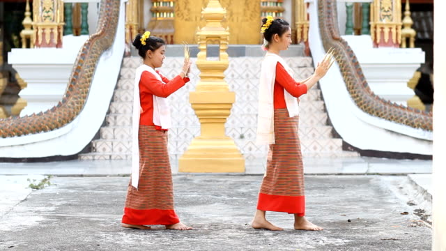 Cute Thai girls dancing at temple