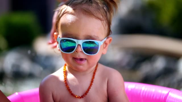 cute toddler boy in inflatable pool - baby boys stock videos & royalty-free footage