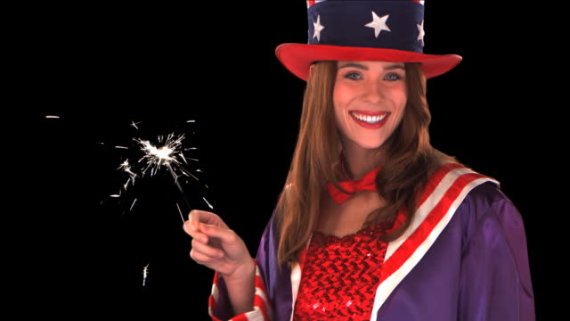 stockvideo's en b-roll-footage met cute uncle sam girl with sparklers close-up - this clip has an embedded alpha-channel - keyable