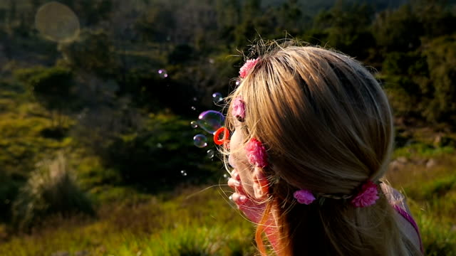 cute woman blowing bubbles - headband stock videos & royalty-free footage