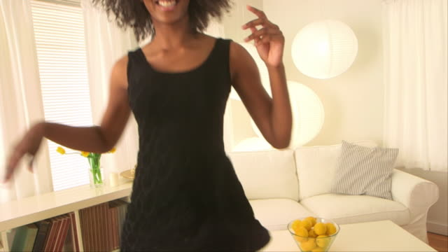 Cute woman dancing in her living room