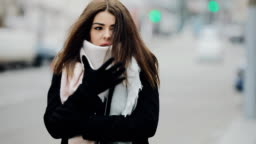 Cute woman freezing walk in frost day at winter city