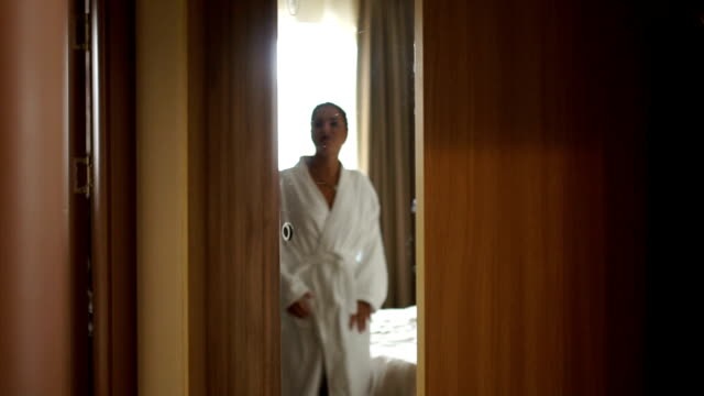 cute woman open wardrobe - bathrobe stock videos & royalty-free footage