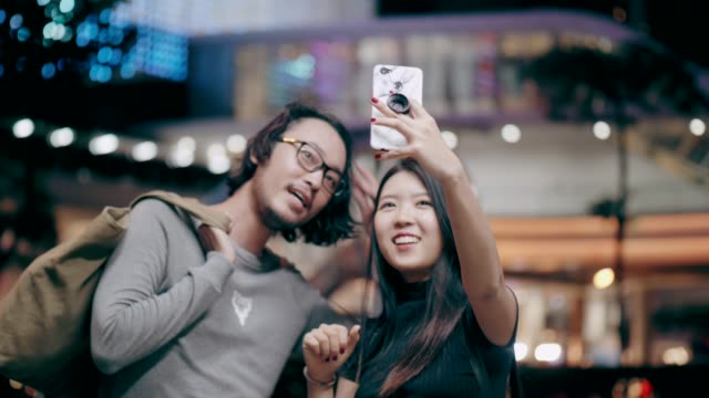 cute woman selfie while traveling in the city - date night romance stock videos and b-roll footage