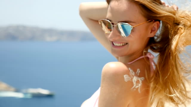 cute woman & summer joy - uv protection stock videos and b-roll footage