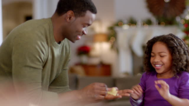cute young girl hands father christmas tree-shaped cookie dough - moulding trim stock videos & royalty-free footage