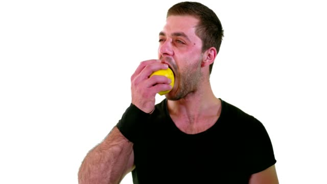 cute young man enjoying eating a green or yellow apple - apple fruit stock videos and b-roll footage