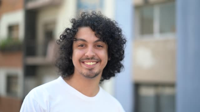 cute young men with curly hair portrait - pardo brazilian stock videos & royalty-free footage