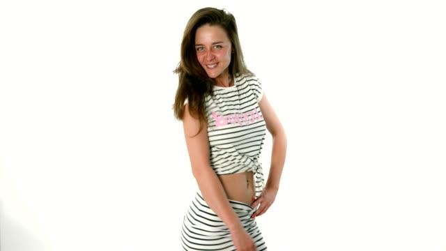Cute young woman fashion model catwalk posing in studio