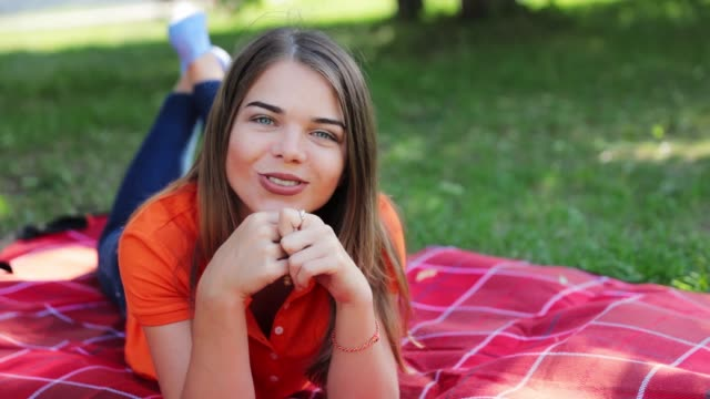 cute young woman laying on the grass - portrait - video hd - video portrait stock videos & royalty-free footage