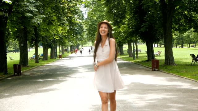 cute young woman walking towards, playing or interacting with the camera - camera photographic equipment stock videos and b-roll footage