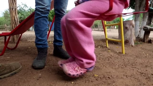 cutin shot of a child on a swing - swinging stock videos & royalty-free footage