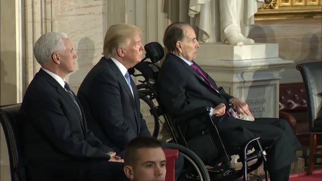Cuts from the Capitol Rotunda as dignitaries gather for a ceremony attended by President Donald Trump Vice President Mike Pence and Congressional...
