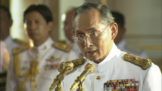 2 cuts king bhumipol delivers speech at prince mahidol award ceremony zooming in from bust shot to close up/big view of prince mahidol award ceremony... - king of thailand stock videos and b-roll footage