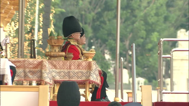 2 cuts long shot of the troop review of the royal thai armed forces/ king bhumibol seated on platform - king of thailand stock videos and b-roll footage